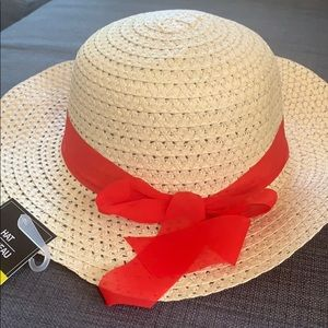 Summer hat with red bow